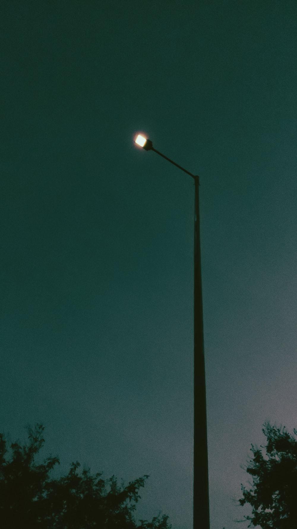 black street light during night time