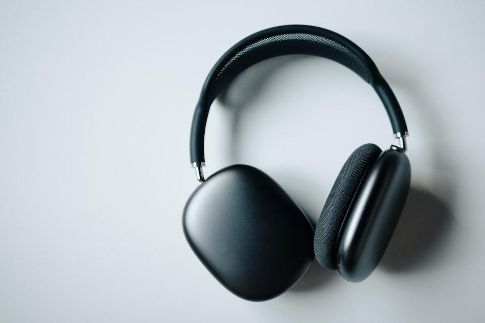 black wireless headphones on white desk