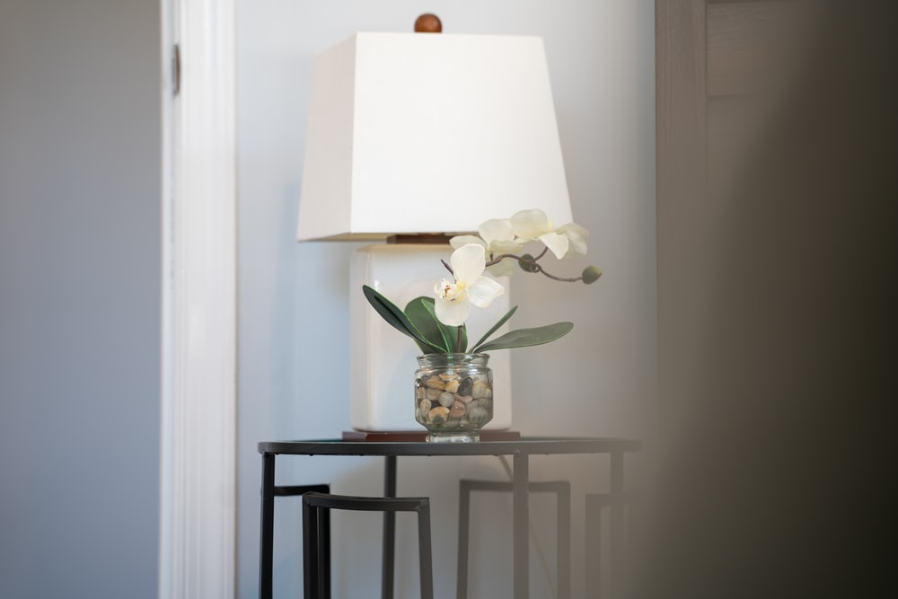 white table lamp on glass table