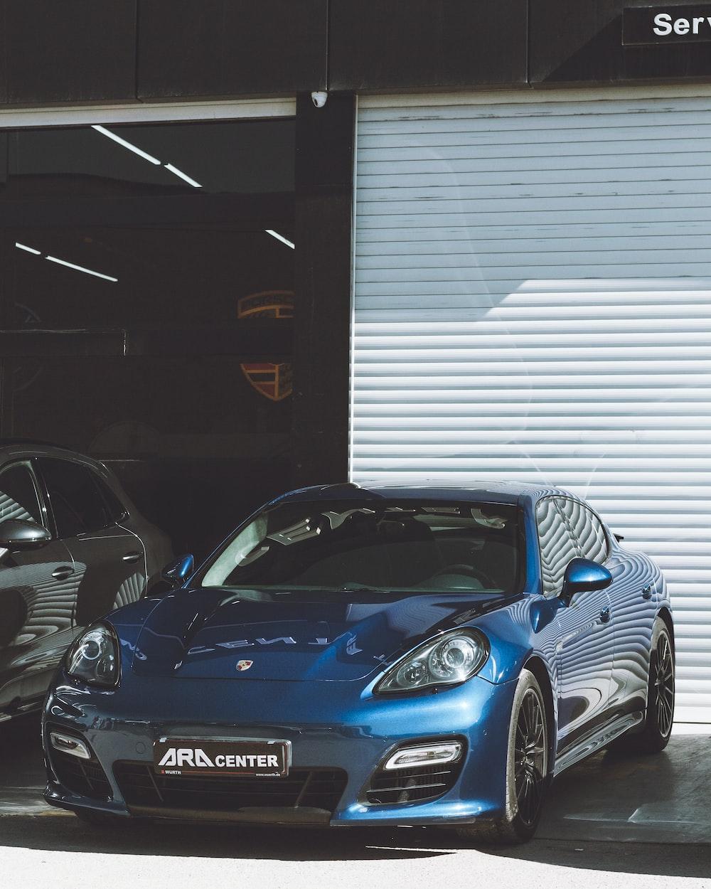 blue porsche 911 parked in garage