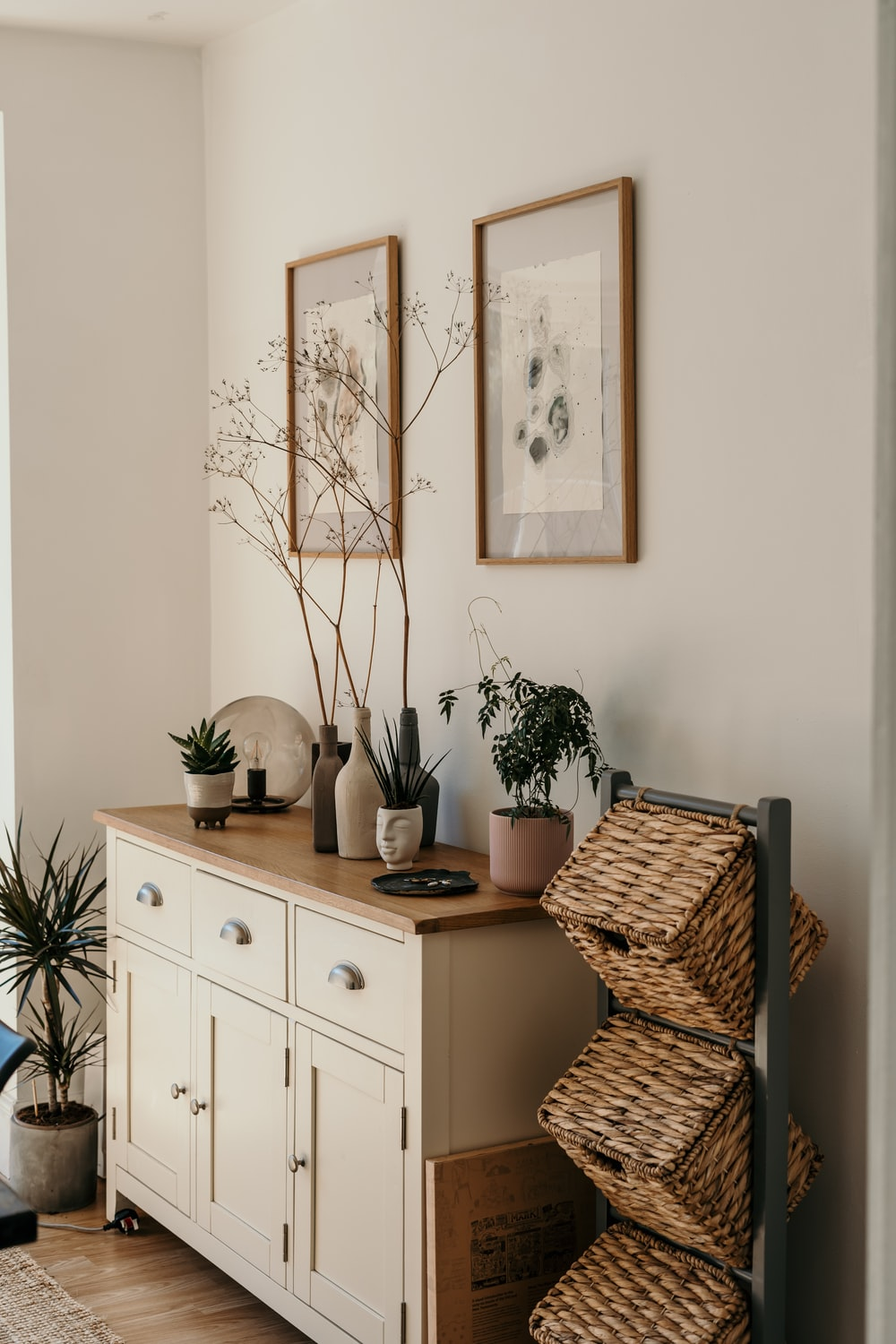 brown woven basket on white wooden cabinet