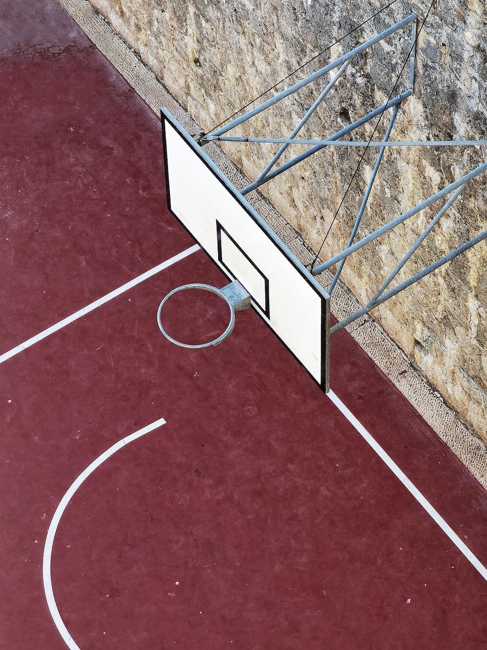 white metal frame on brown floor