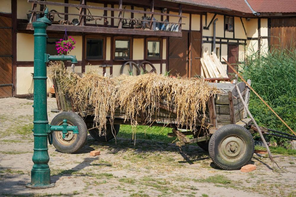 brown wooden cart with brown hays