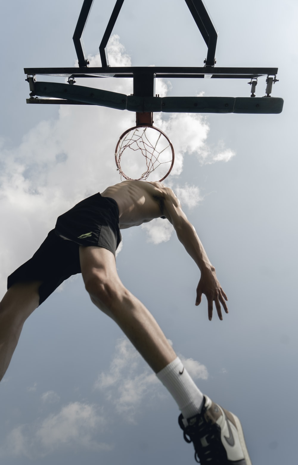woman in black tank top and black shorts playing basketball