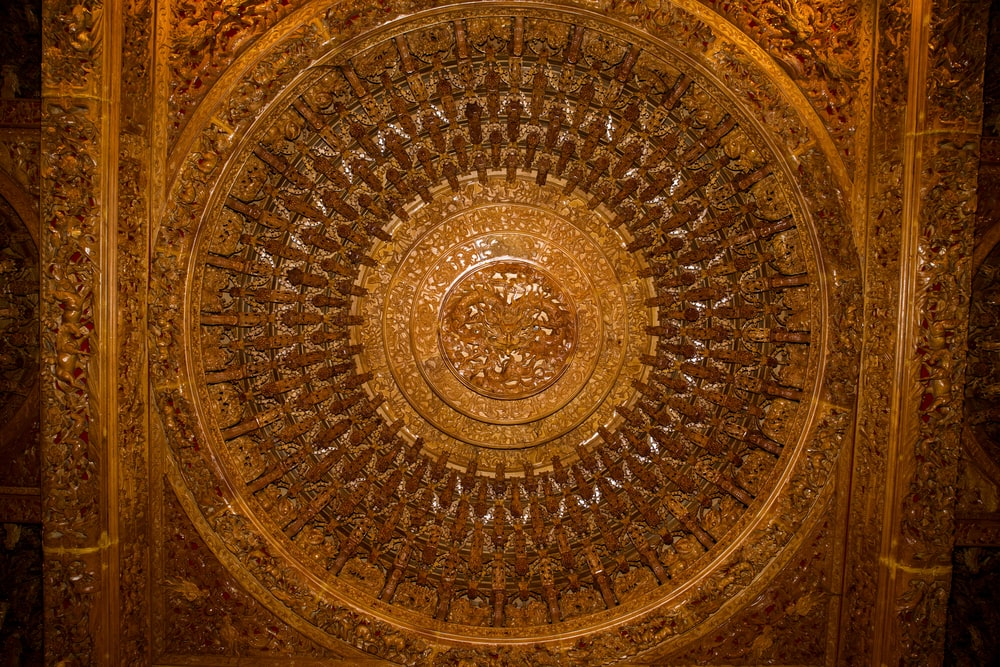 gold and black round wall decor