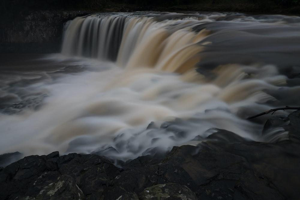 white water falls during daytime