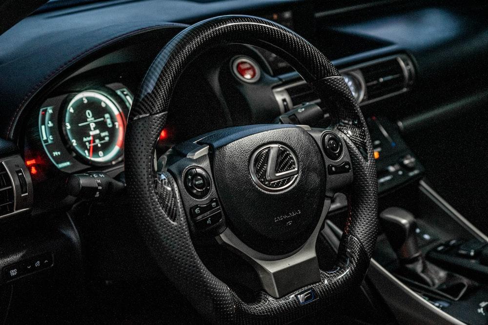 black and gray nissan steering wheel