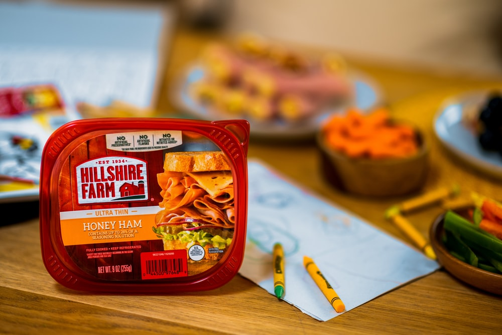 red and yellow plastic pack on brown wooden table