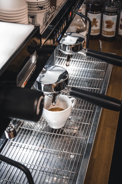 white ceramic mug on stainless steel espresso machine