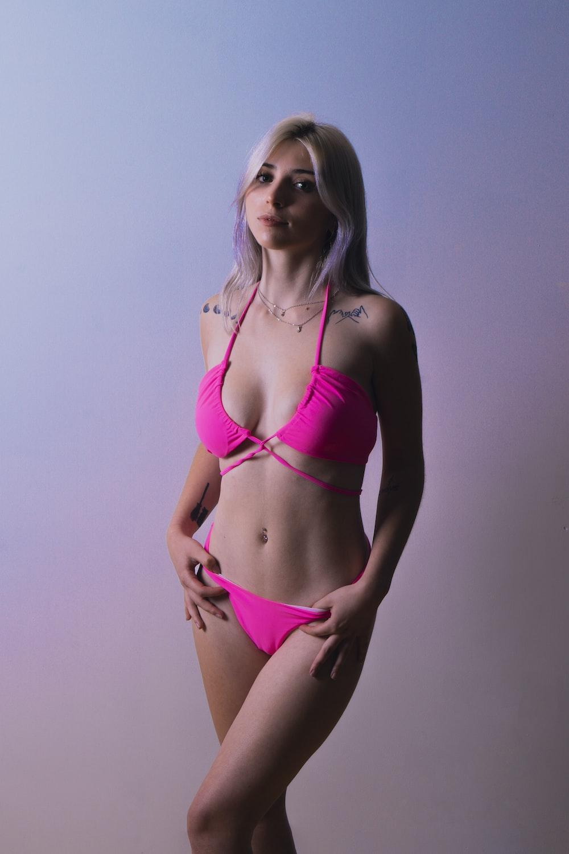 woman in pink bikini posing for photo