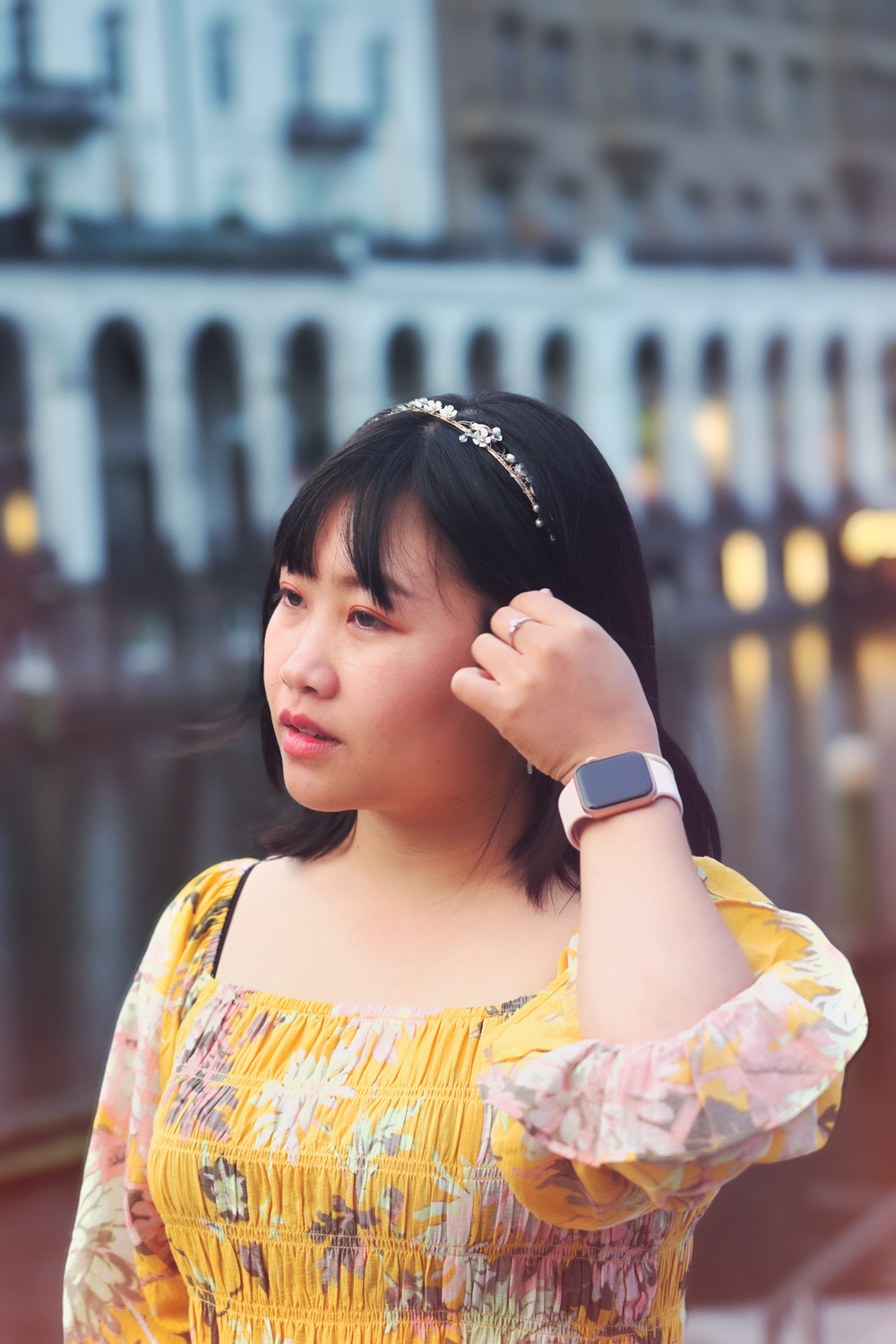 woman in yellow and white floral dress wearing white and gold watch
