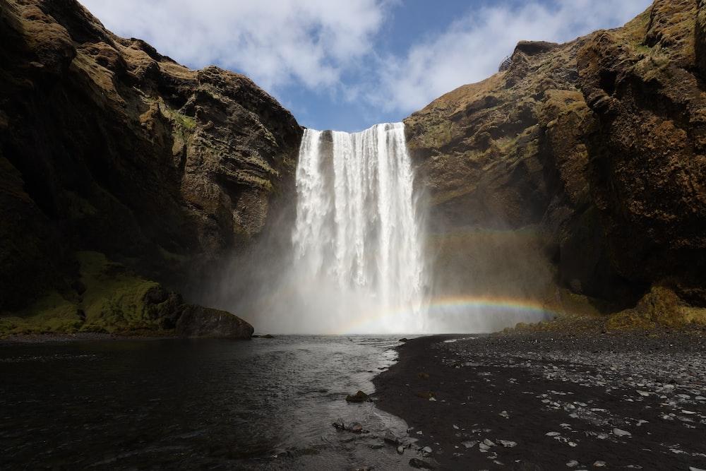 waterfalls under blue sky during daytime