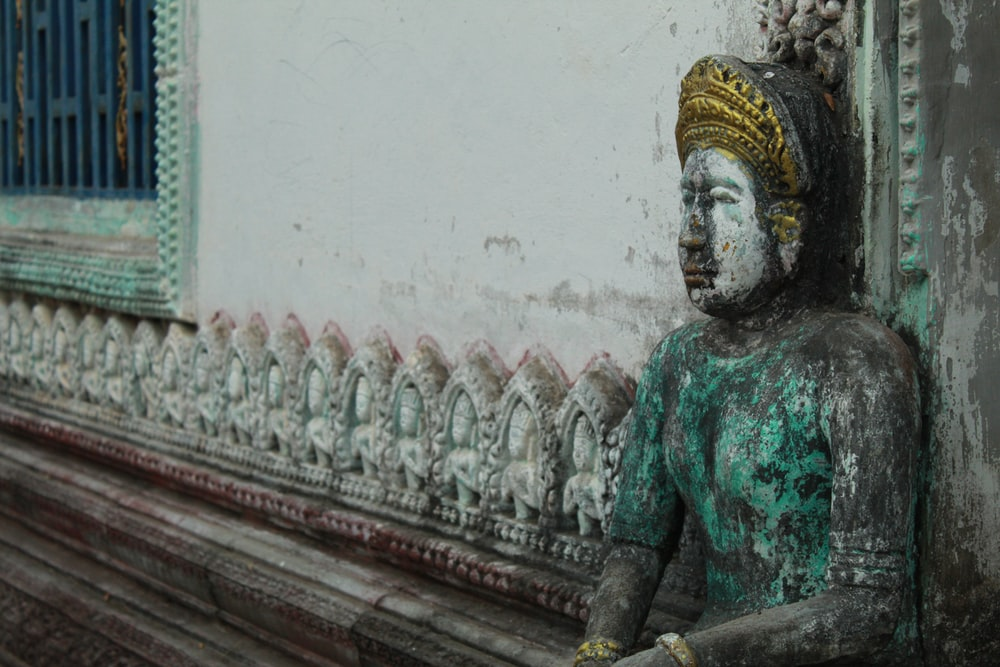 green and gold hindu deity statue