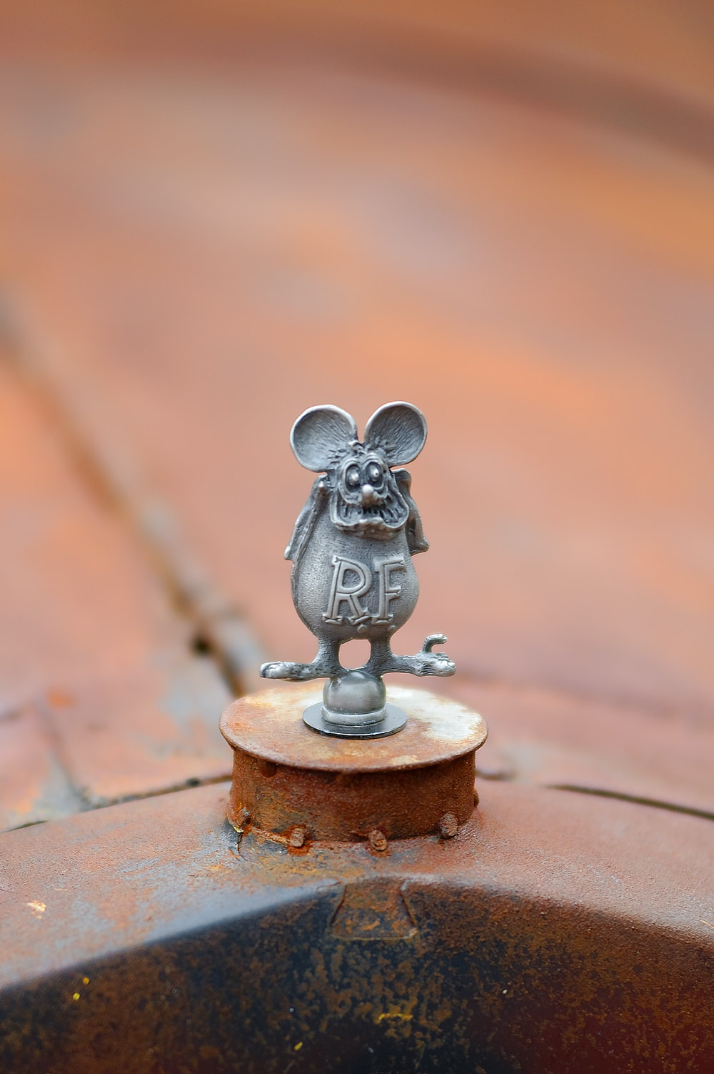 gray cat figurine on brown wooden table