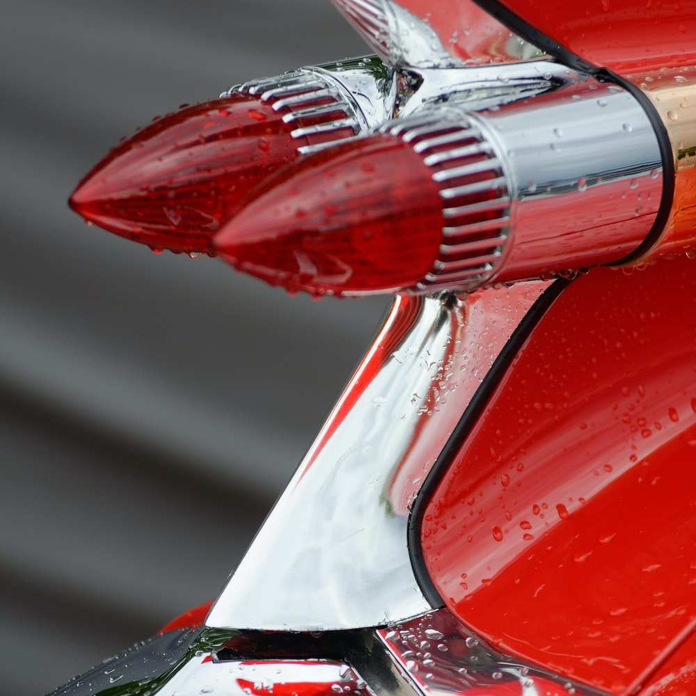 red car side mirror during daytime