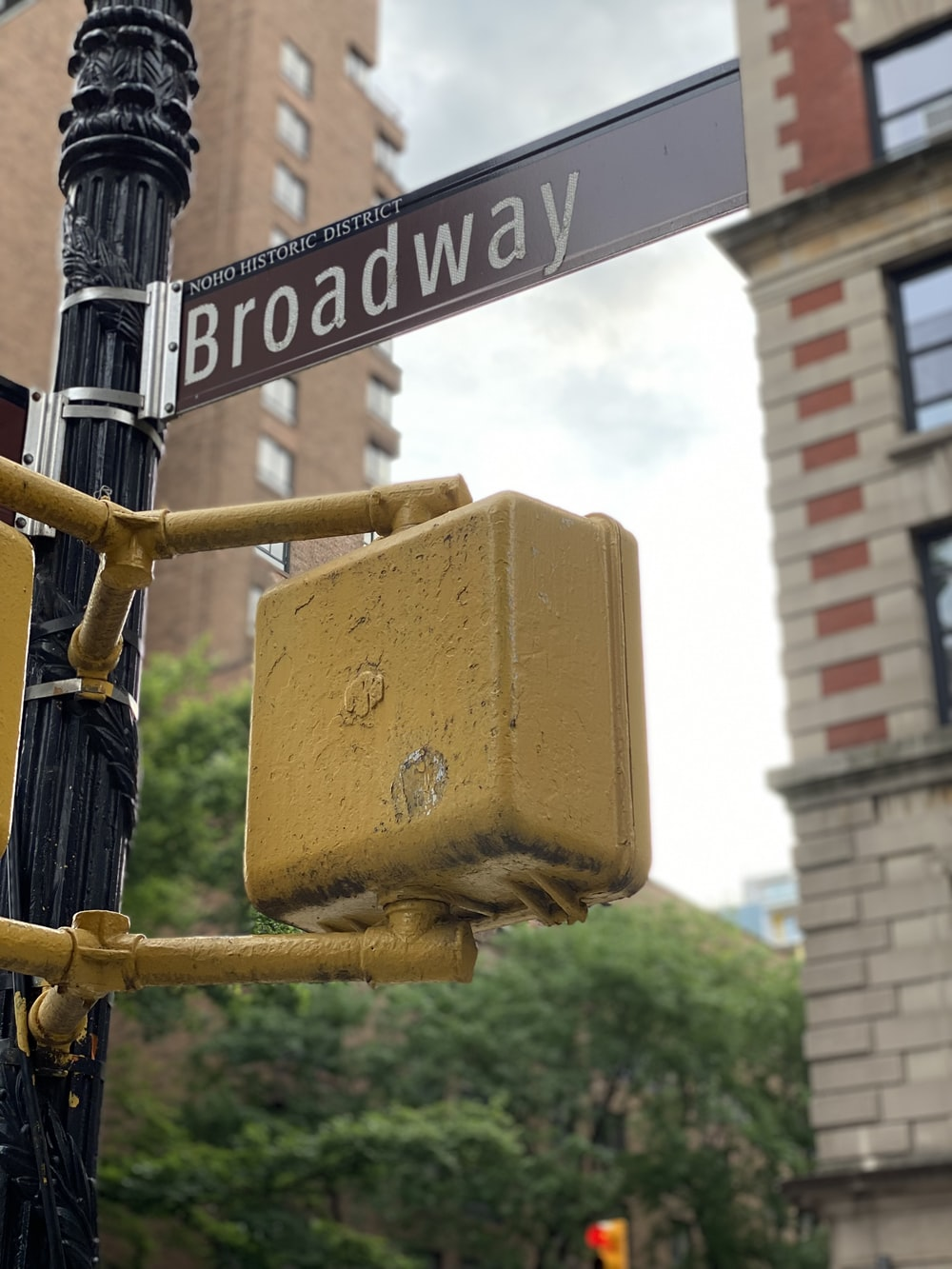 yellow and black street sign