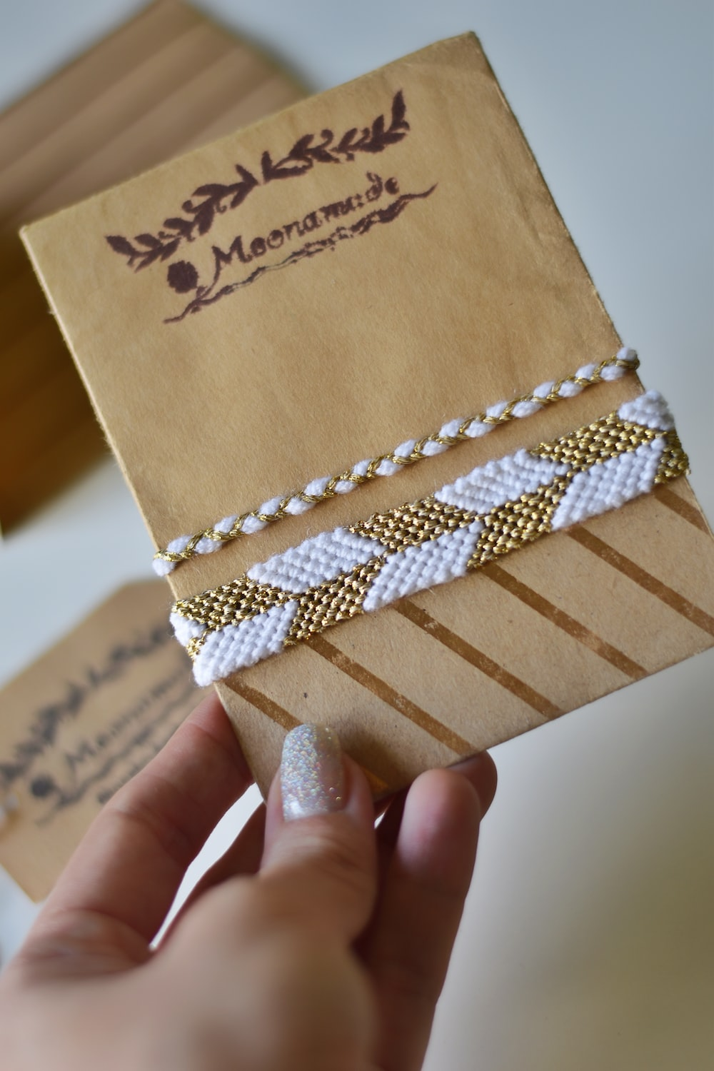 brown and white box with white and brown ribbon