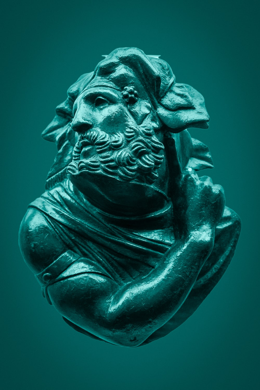 green concrete statue of man