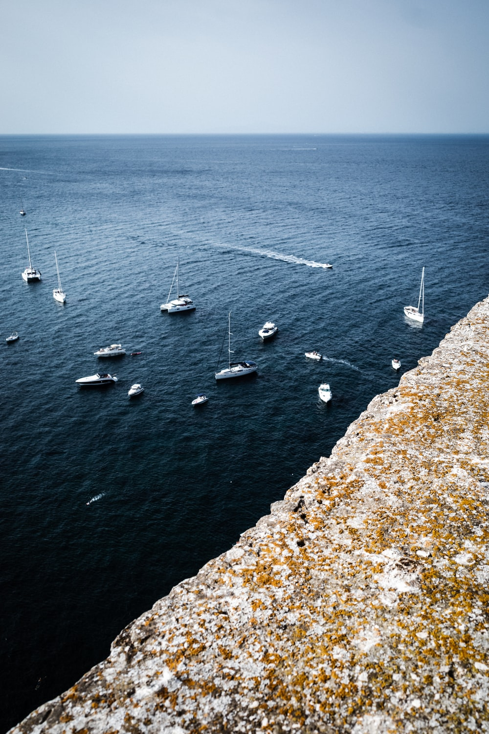 white boats on sea during daytime