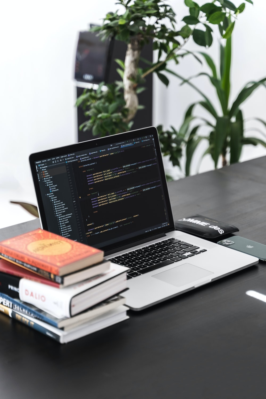 macbook pro on black wooden table