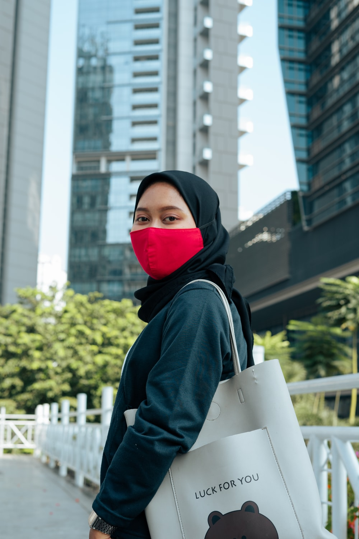 woman in black hoodie wearing red hijab
