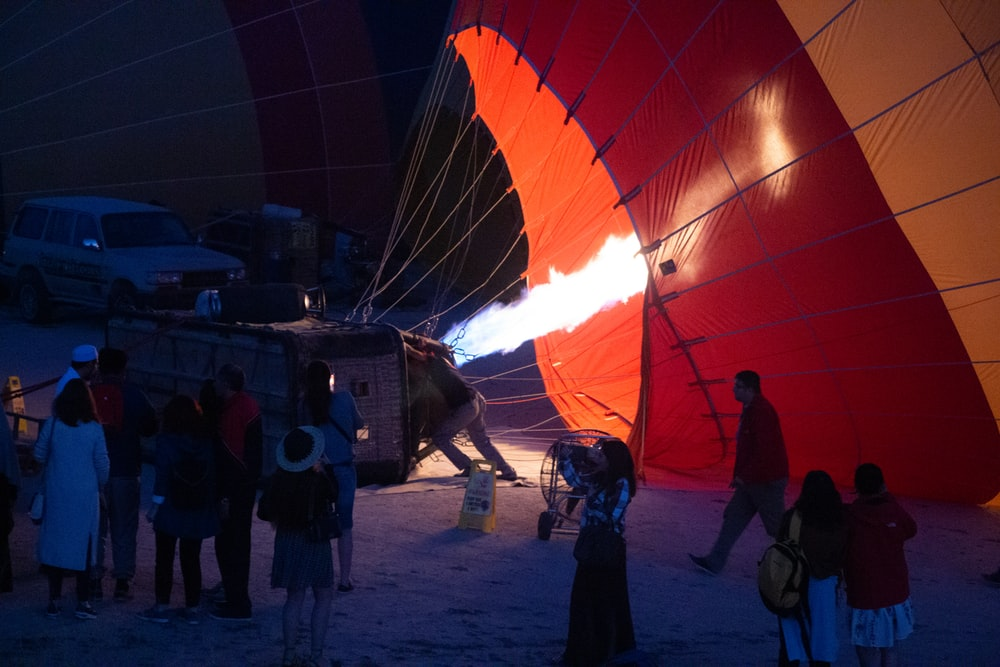 people standing near hot air balloons during daytime
