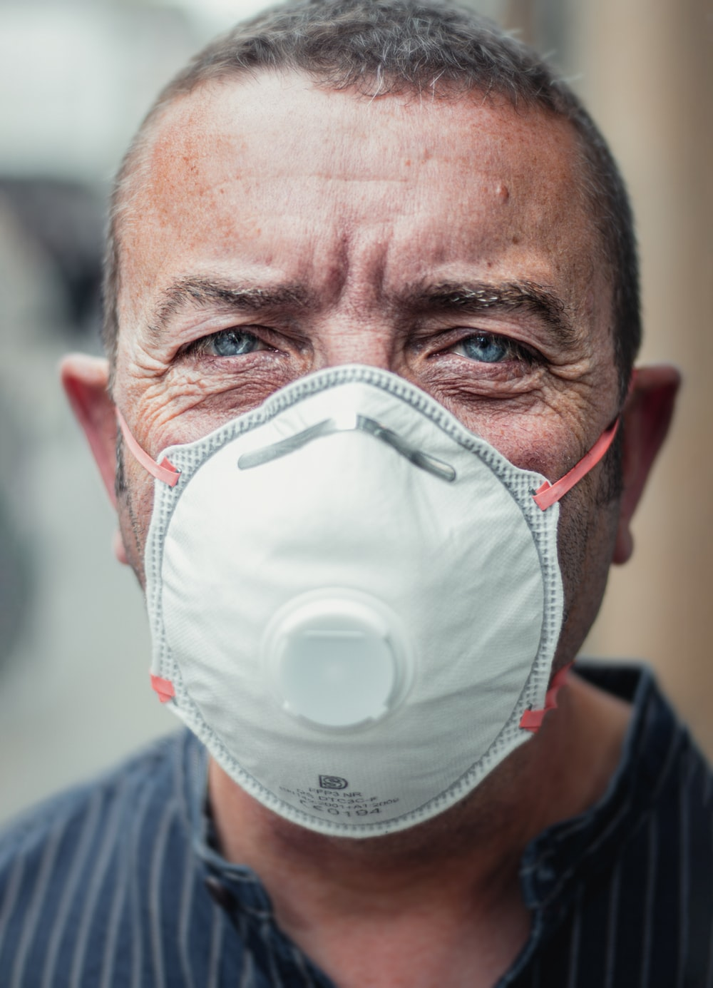 man in white face mask
