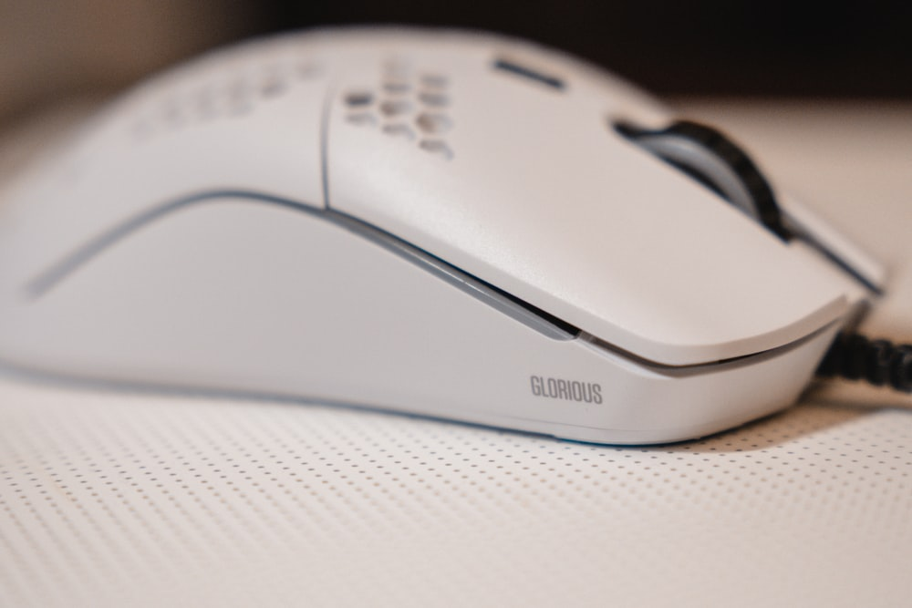 white and black cordless computer mouse