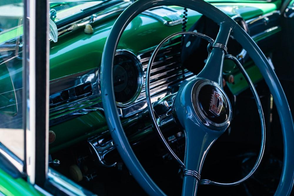 green and black car steering wheel
