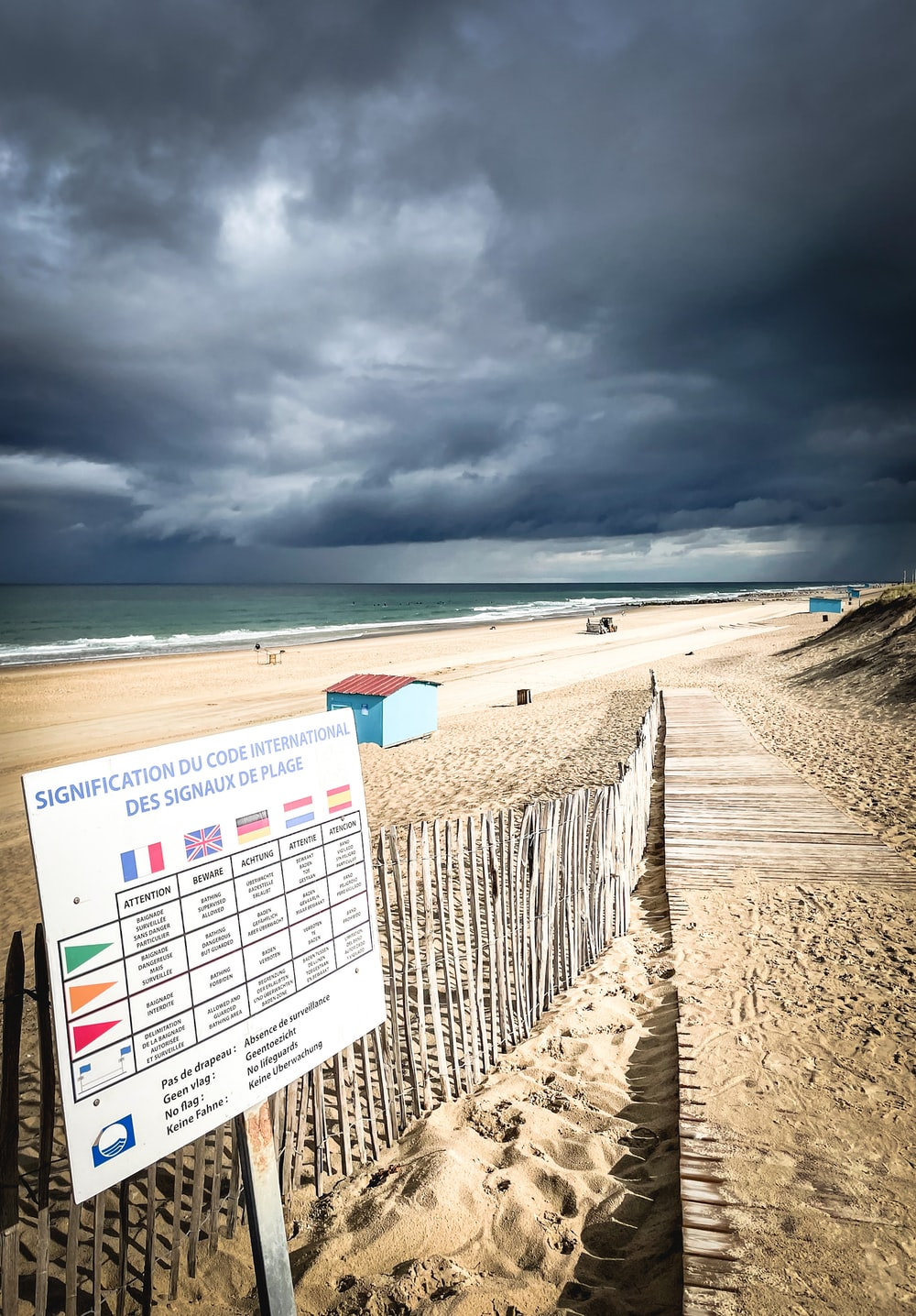 white and black calendar on beach under cloudy sky during daytime