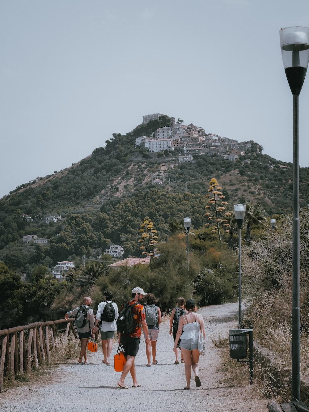 people walking on brown wooden bridge during daytime