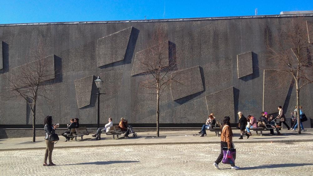 people walking near gray concrete building during daytime