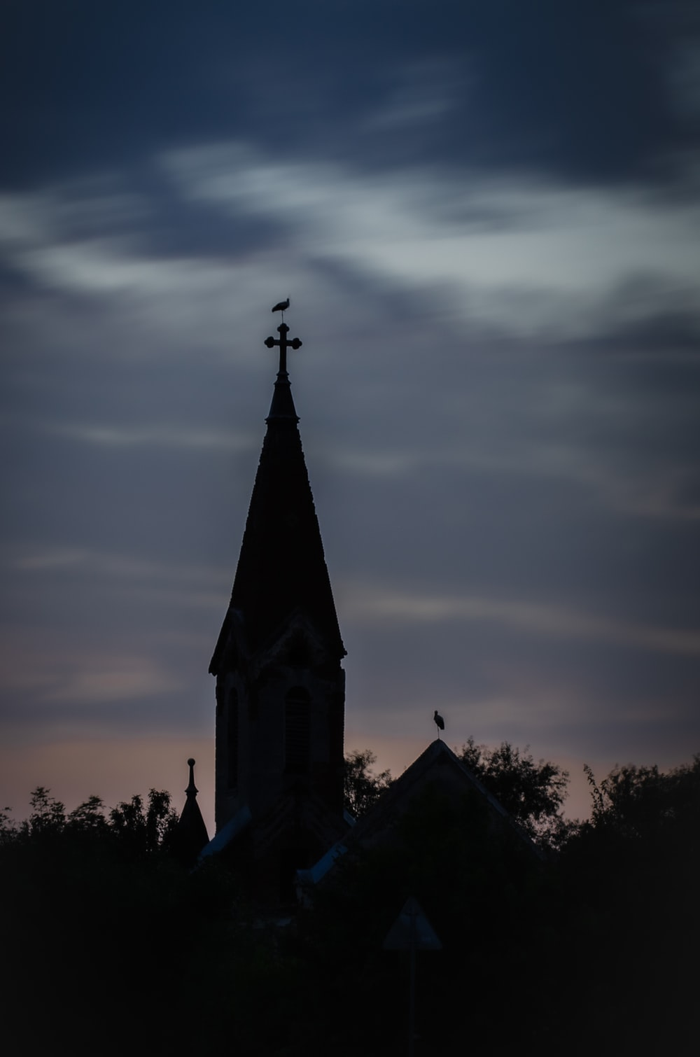 silhouette of church during sunset