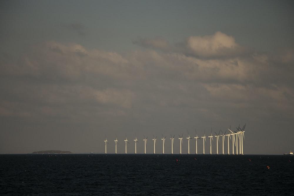 white wooden bridge over the sea