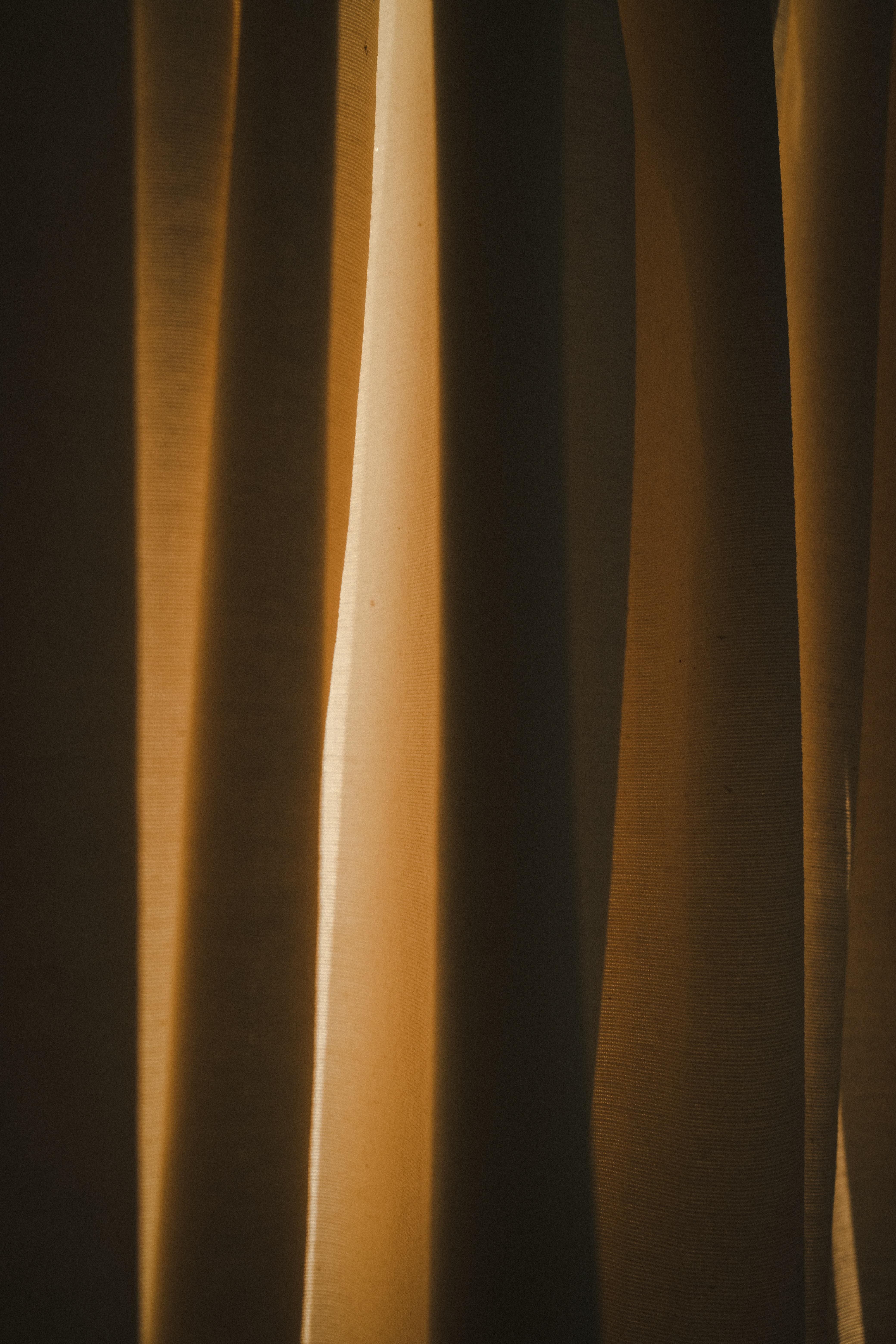 Golden hour light in curtain.
