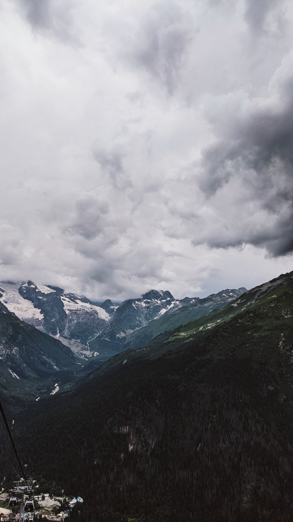 green and white mountains under white clouds