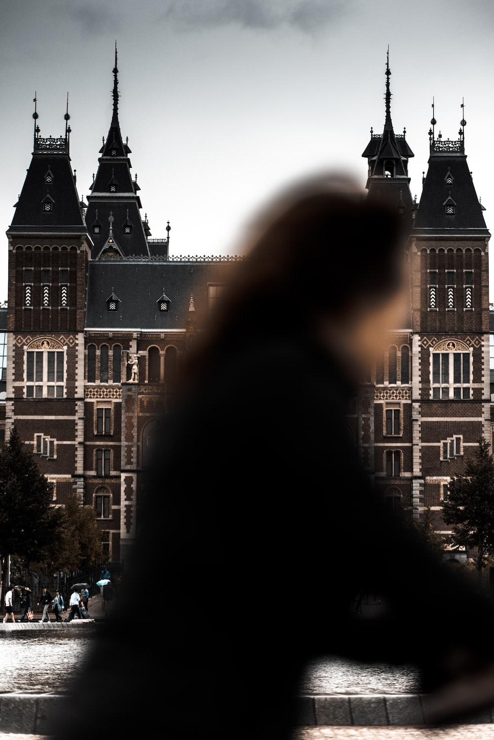 people walking near brown concrete building during daytime
