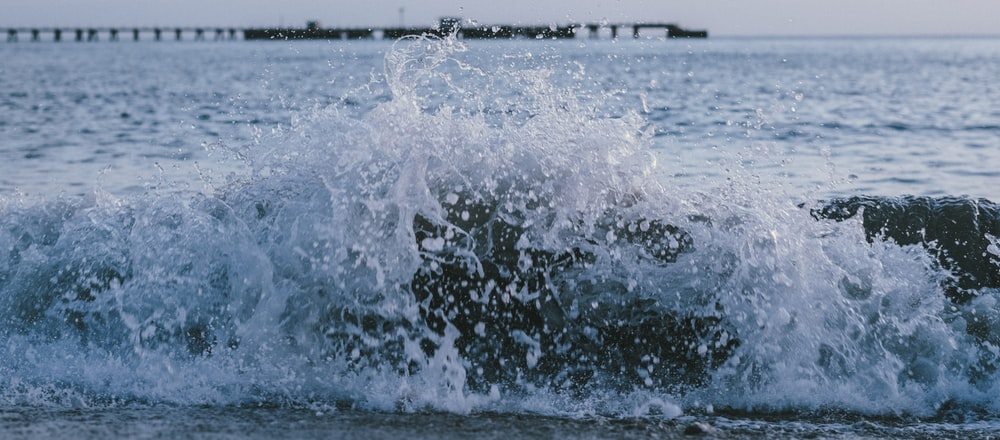 water waves on beach shore during daytime