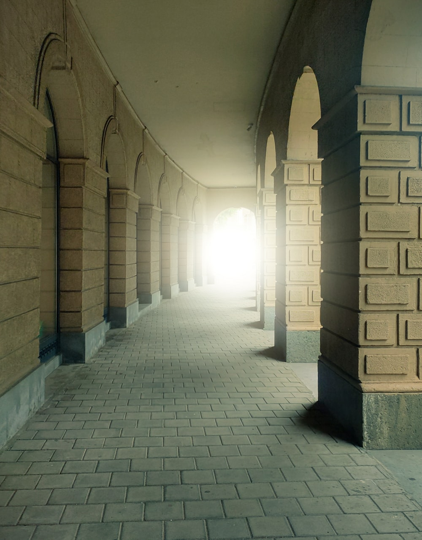 gray and brown brick hallway