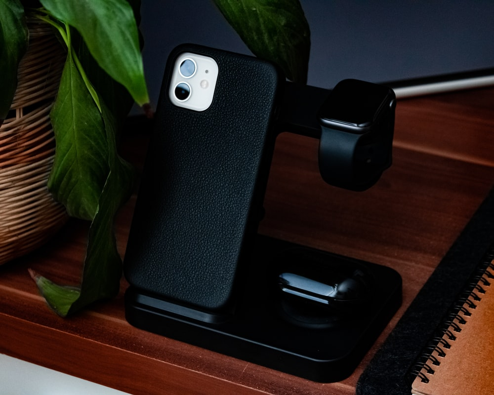 black iphone case on brown wooden table