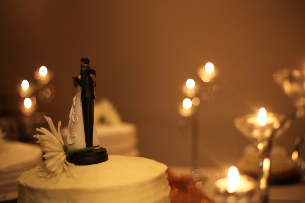 black and white ceramic figurine on white round cake