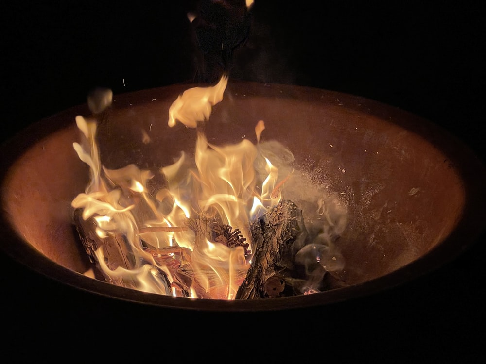 fire in brown round fire pit