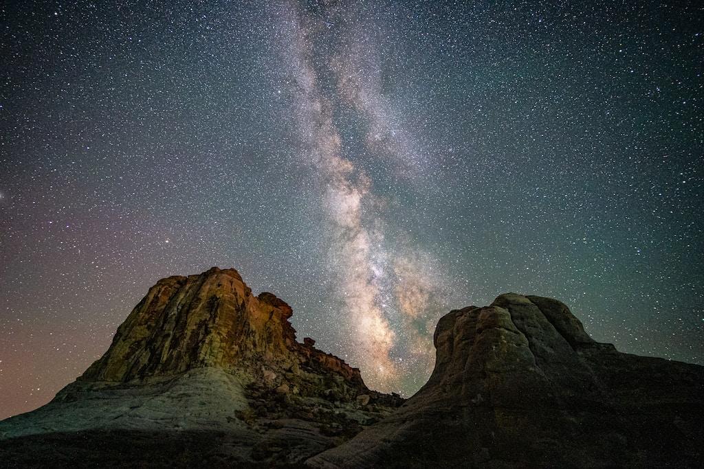 brown rocky mountain under starry night