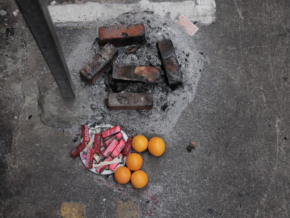 orange fruit on gray concrete floor