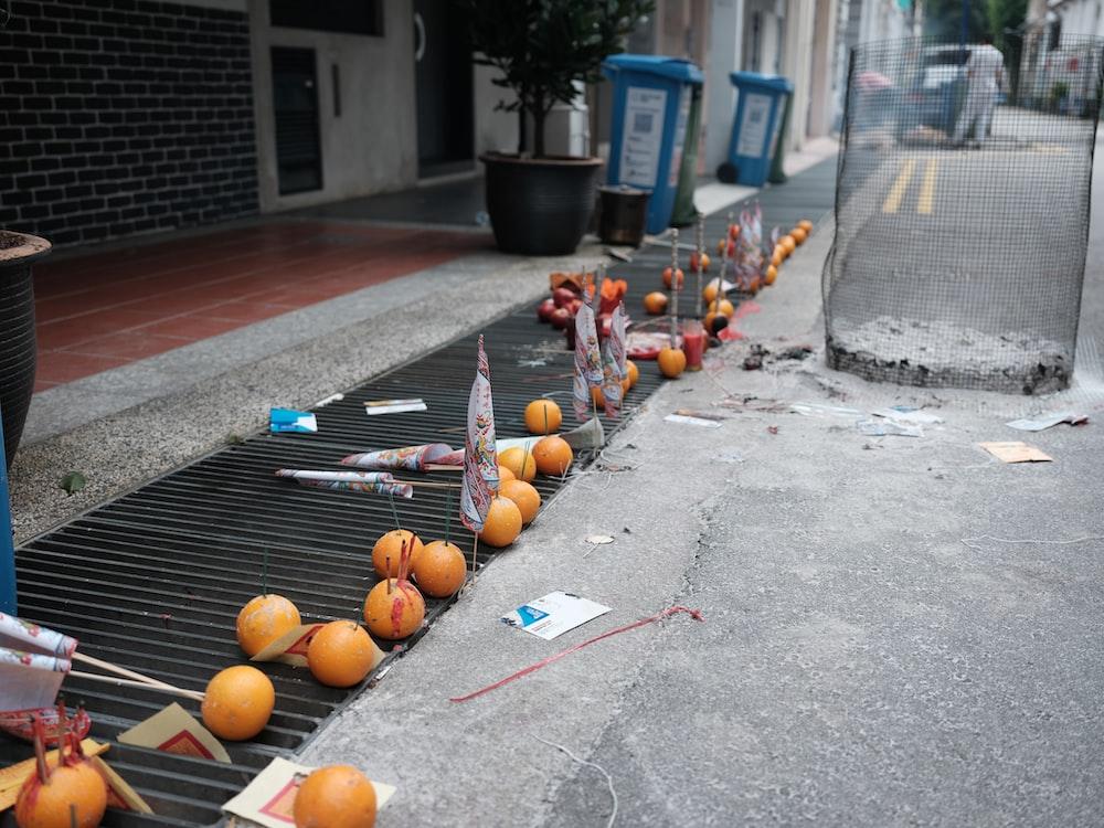 orange fruits on gray concrete floor during daytime