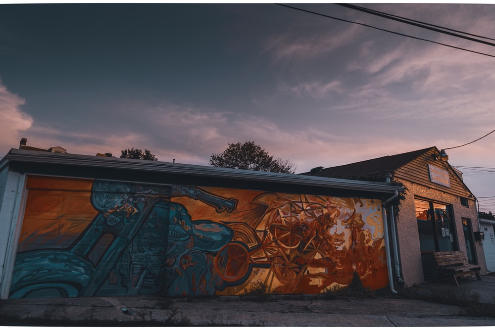 brown and black graffiti on wall