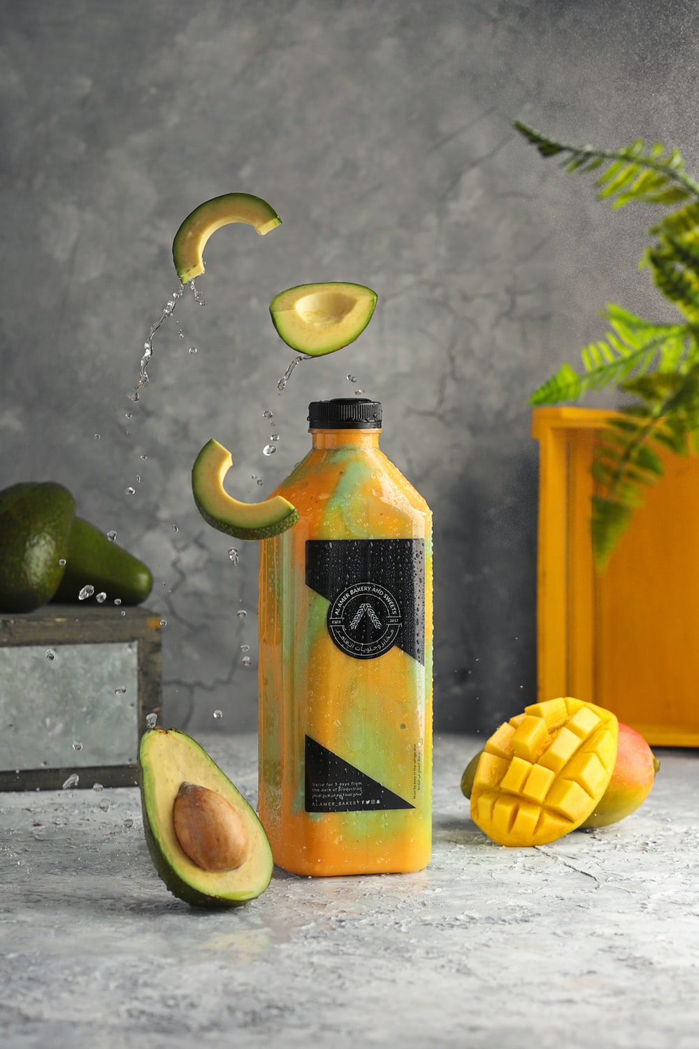 yellow and black bottle with water