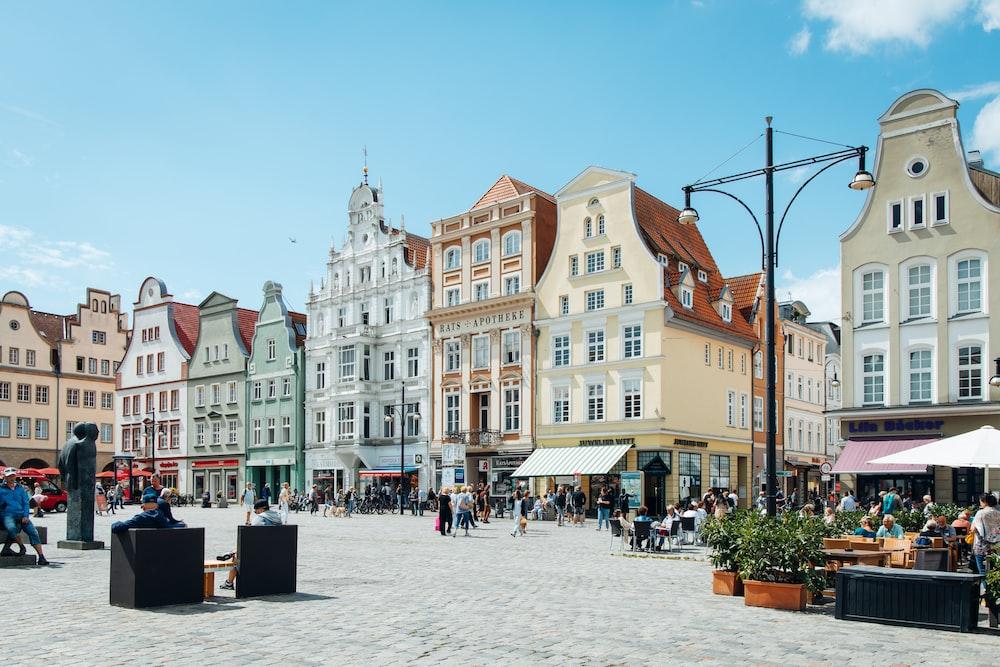 people walking on street near buildings during daytime