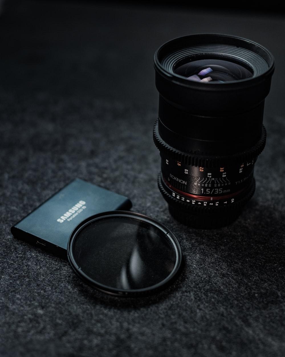 black camera lens beside black samsung galaxys 7 edge