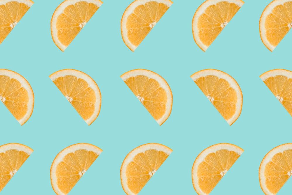 sliced orange fruits on white background